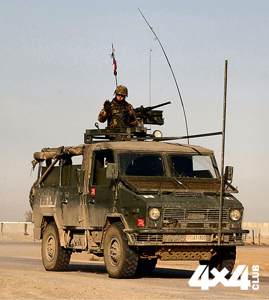 An Italian Army personnel waves as he departs Tallil AB Iraq, at the start of convoy escort duty.  The Italian Army personnel are deployed to Tallil AB Iraq as coalition partners in support of Operation IRAQI FREEDOM. USAF image by MSgt Mark Bucher Cleared by 407 AEG/PAO MSgt Terry Nelson